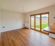 Family room leading to rear garden with folding patio door set.