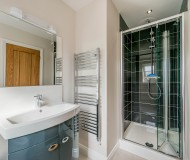 Modern En-suite shower room attached to master bedroom.