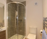 Cloak and downstairs shower room